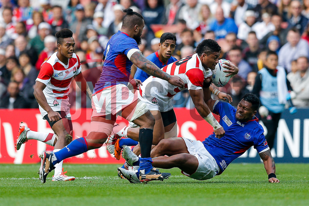 Japan replacement Amanaki Lelei Mafi is tackled by Samoa Outside Centre Paul Perez - Mandatory byline: Rogan Thomson/JMP - 07966 386802 - 03/10/2015 - RUGBY UNION - Stadium:mk - Milton Keynes, England - Samoa v Japan - Rugby World Cup 2015 Pool B.