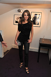 ELIZABETH HURLEY at a private view of photographs by Anthony Souza held at The Little Black Gallery, 13A Park Walk, London SW10 on 13th December 2011.