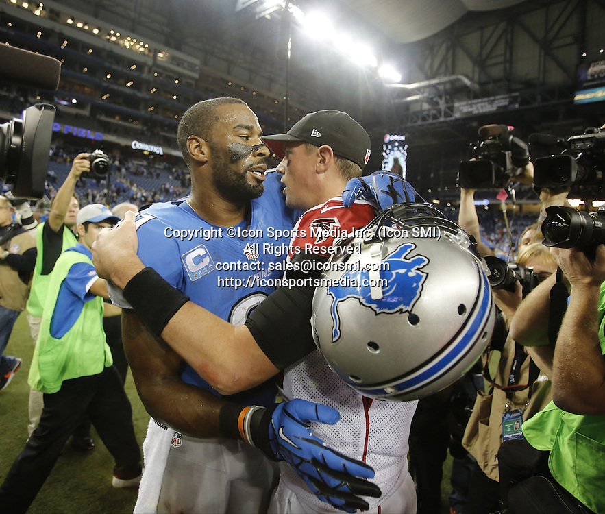 Dec. 22, 2012 - Detroit, MI, USA - Detroit Lions wide receiver Calvin Johnson with Atlanta Falcons quarterback Matt Ryan after the Falcons' 31-18 win at Ford Field in Detroit, Michigan, on Saturday, December 22, 2012. Johnson's 225 receiving yards lifted him over Jerry Rice for the NFL's single-season receiving yardage record.