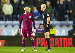 WIGAN, ENGLAND - Monday, February 19, 2018: Manchester City's David Silva argues with referee Anthony Taylor at half-time during the FA Cup 5th Round match between Wigan Athletic FC and Manchester City FC at the DW Stadium. (Pic by David Rawcliffe/Propaganda)