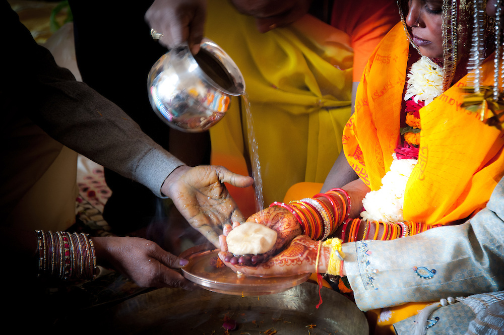 One of the most significant rituals the bride and the groom perform is the Saptapadi or saat phere around a scared fire and light, which is symbolic to God. While the bride and the groom take the seven circles, the priest or purohit recites the mantras and speak of the real essence and significance of marriage. It is also during this time that the groom fills vermillion or sindoor in the center parting of the bride and puts mangalsutra around her neck. Both sindoor and mangalsutra have strong religious implications and are sacred symbols of a married woman. These are some of the rituals and customs, which were generally followed in all the Hindu marriages. [source: iloveindia.com]