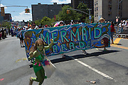 The official banner of the parade is carried down the parade route.