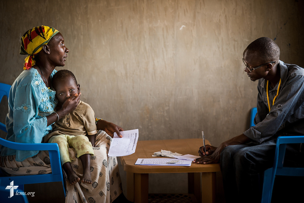 A mother and child talk to a Kenyan health worker at the LCMS Mercy Medical Team on Monday, June 20, 2016, in Nataparkakono, a village in Turkana, Kenya.  LCMS Communications/Erik M. Lunsford