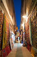 Small lane selling Moroccan rugs, Essaouira, Morocco