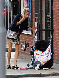 (EXCLUSIVE PICTURES) Soon to be Mrs Cohen - Peaches Geldof was spotted out with baby Astala in east London. Whilst talking to a friend on her mobile phone, unbeknown to Peaches in her path  was a pothole in the pavement. Little Astala and buggy toppled over which nearly sent Astala flying out of his buggy but luckly he was unharmed. Peaches then picked Astala up to reasure him and put him back in the buggy and tweeted: <br /> <br /> 'Was just walking with Astala in his pram and there was a massive hole in the pavement I didn't see as was pushing the pram and the pram... <br /> <br /> - fell into it and toppled over! Thankfully Astala didn't fall out as was strapped in and so'<br /> <br /> Didnt get hurt at all or cry. But still the London pavements are SO dangerous!<br /> <br /> If he had fallen out he could have seriously hurt himself! And it's impossible to see these cracks When pushing a pram.<br /> <br /> The mayor of london should do something about it it's ridiculous! Thank god Astala is ok! X<br /> 06/09/2012<br /> <br /> BYLINE MUST READ : JAMESY/GOTCHA IMAGES<br /> <br /> Copyright by © Gotcha Images Ltd. All rights reserved.<br /> Usage of this image is conditional upon the acceptance <br /> of Gotcha Images Ltd, terms and conditions available at<br /> www.gotchaimages.com