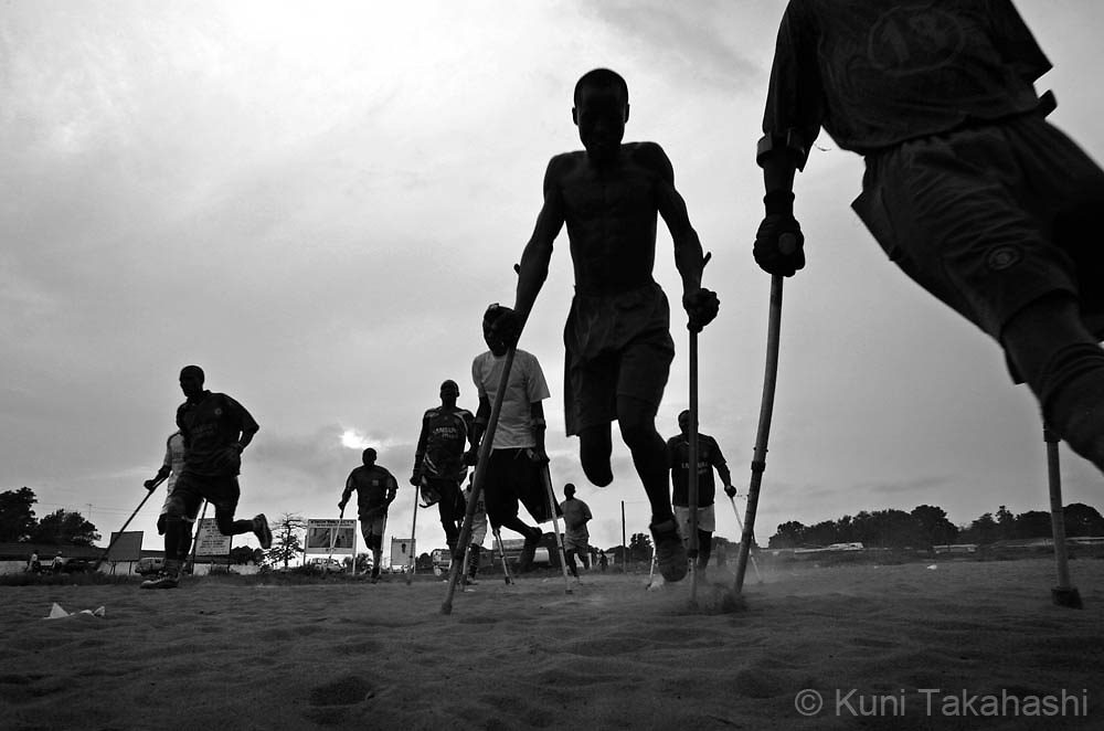 Amputee football players practice in Monrovia, Liberia, April 25, 2008. The Liberian National team won the 2008 All Africa Amputee Cup of Nations, but the players - many of them ex-combatants and homeless - continue to struggle, receiving no support from the government or the amputee football league federation.