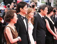 Youn Yuh-jung, Yu Junsang, Isabelle Huppert, Hong Sangsoo, Moon Sori arriving at the DA-REUN NA-RA-E-SUH (IN ANOTHER COUNTRY)  gala screening at the 65th Cannes Film Festival France. Monday 21st May 2012 in Cannes Film Festival, France.
