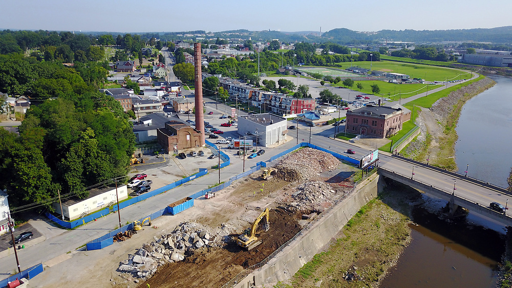 The former Pennsupreme smoke stack still stands as the buildings around it have been demolished in preparation for the York Academy, Tuesday, Aug. 1, 2017. John A. Pavoncello photo