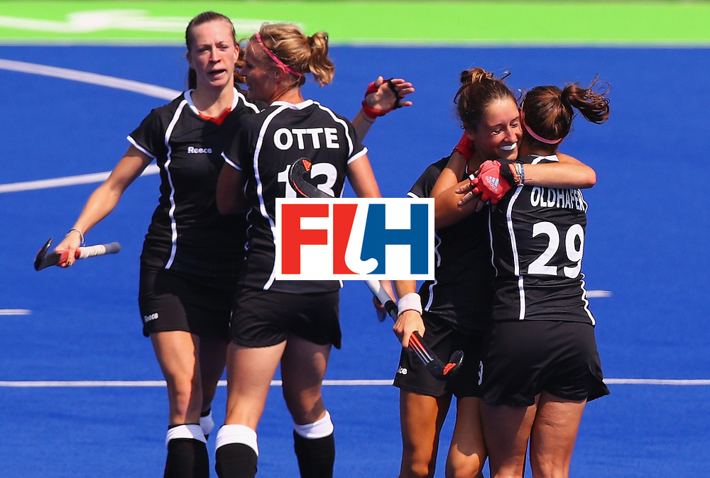 RIO DE JANEIRO, BRAZIL - AUGUST 19:  Lisa Schutze #11 (2nd-R) celebrates with Pia-Sophie Oldhafer #29 of Germany after scoring a goal during the Women's Bronze Medal Match against New Zealand on Day 14 of the Rio 2016 Olympic Games at the Olympic Hockey Centre on August 19, 2016 in Rio de Janeiro, Brazil.  (Photo by Tom Pennington/Getty Images)