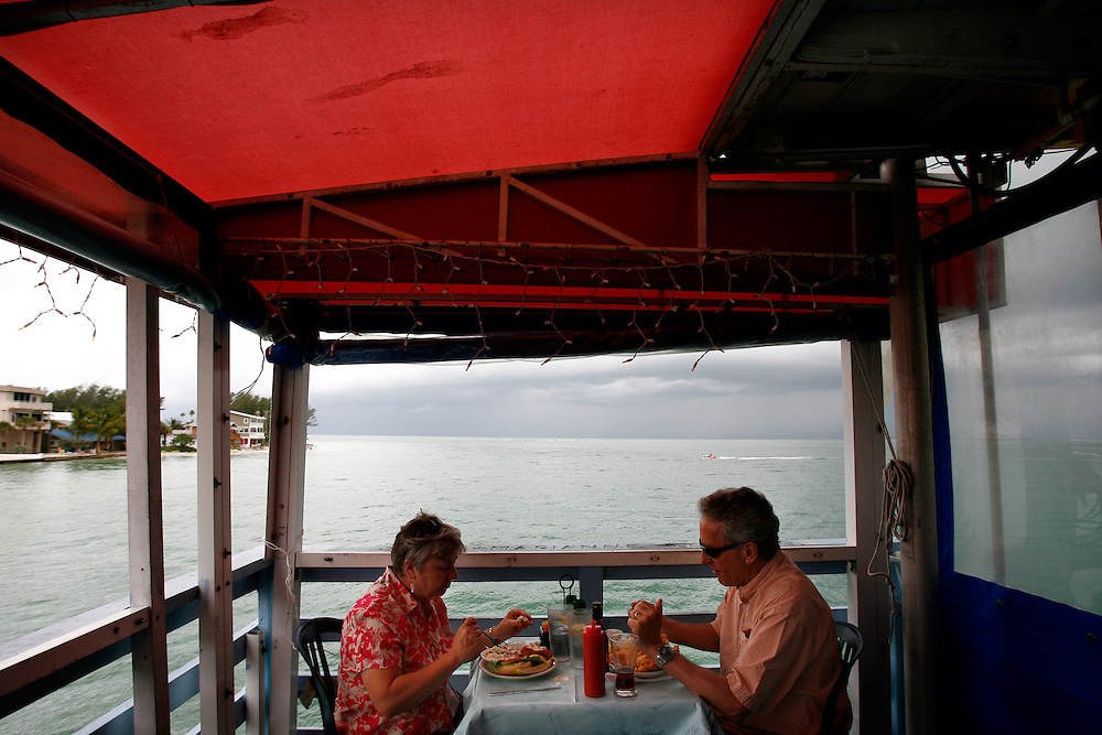 ANNA MARIA ISLAND, FL -- July 9, 2009 -- Ray and Maureen Flock, part-time residents of Anna Maria, eat the grouper sandwich and fish n' chip respectively at Rod & Reel Pier on Anna Maria Island in Manatee County, Fla., on Thursday, July 9, 2009.