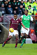 Arnaud Djoum (#10) of Heart of Midlothian controls the ball under pressure from Marvin Bartley (#6) of Hibernian during the William Hill Scottish Cup 4th round match between Heart of Midlothian and Hibernian at Tynecastle Stadium, Gorgie, Scotland on 21 January 2018. Photo by Craig Doyle.