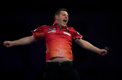 Toni Alcinas celebrates winning his match against Peter Wright during day four of the William Hill World Darts Championships at Alexandra Palace, London.