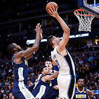 11 November 2017: Orlando Magic center Nikola Vucevic (9) goes for the layup during the Denver Nuggets 125-107 victory over the Orlando Magic, at the Pepsi Center, Denver, Colorado, USA.