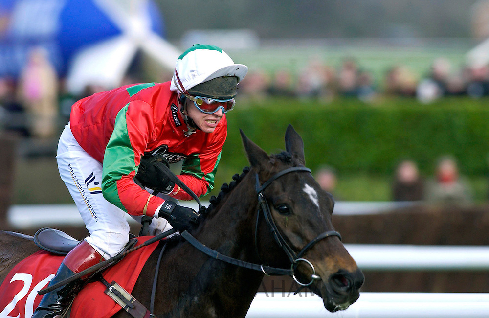 Jockey Richard Johnson riding race horse Jimmy Tennis in the Royal and Sun Alliance Chase at the Cheltenham Festival.