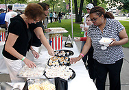 Folks gets samples from What's Poppin' during the 21st annual The Taste in the Lincoln Park Commons area at the Fraze Pavilion, Thursday, September 3, 2009.