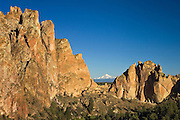 Cliffs at Smith Rock State Park in central Oregon with Mount Jefferson visible through Asterisk Pass.