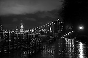 Walking on a rainy day on the Brooklyn Heights Promenade, by night, with the Empire state and the chrysler Building lights in the background, New york, 2009.