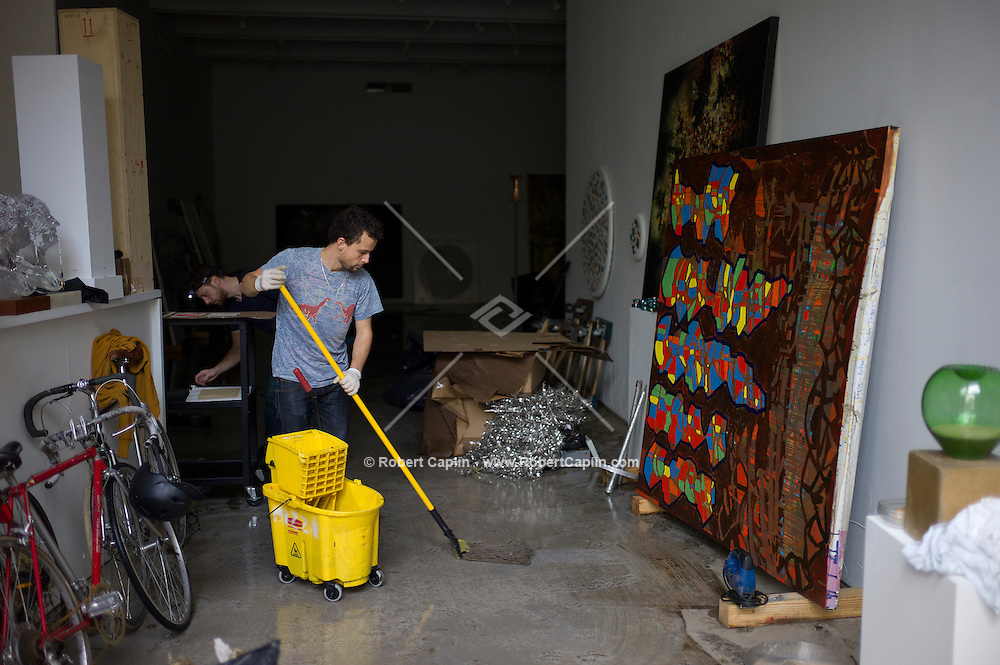 Artwork is removed from CRG Gallery in Chelsea as workers clean up storm and flood damage to the gallery after Hurricane Sandy ravaged New York. ..Photo by Robert Caplin...