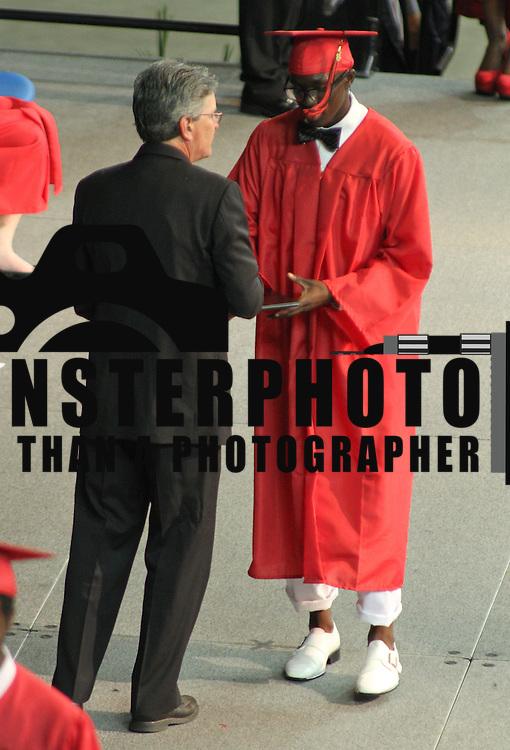 06/06/13 Newark DE:  William Penn High School student receives his diploma during commencements exercises Thursday, June 6. 2013, at The Bob Carpenter Center in Newark Delaware.