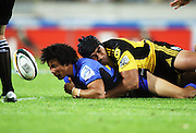 Victor Vito knocks the ball from Chris O'Young's hands in the tackle.<br /> Super 14 rugby match - Hurricanes v Western Force at Westpac Stadium, Wellington. Saturday, 20 February 2010. Photo: Dave Lintott/PHOTOSPORT