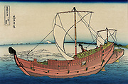 Two trading vessels under sail, view of Mount Fuji in distance.  From 'Thirty-six Views of Mount Fuji', c1831. Katsushika Hokusai (1760-1849) Japanese Ukiyo-e artist.  Seascape Japan Transport Trade Shipping Sail