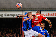 Brett Williams wins a header during the The FA Cup match between Aldershot Town and Rochdale at the EBB Stadium, Aldershot, England on 7 December 2014.
