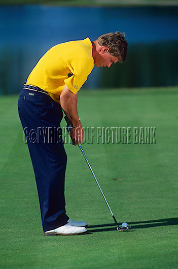 Simon Holmes Putting drill to encourage correct use of shoulders and arms, by placing club across chest, to encourage a good putting stroke.<br /> EDITORIAL USE ONLY-NO MODEL RELEASE.
