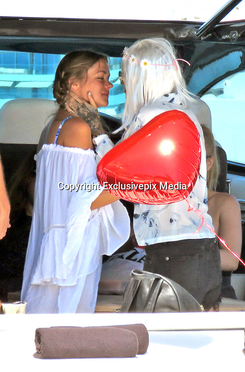 EXCLUSIVE IBIZA, SPAIN, 2016, AUGUST 04 <br /> <br /> Ruby Rose, enjoys every day of his beautiful girlfriend, entrepreneurial Harley Gusman. So much so that the dj surprised his girl with a gray wig, gown adorned with flowers and sixties style, plus a heart shaped balloon. Harley thanked him with a loving kiss<br /> &copy;Exclusivepix Media