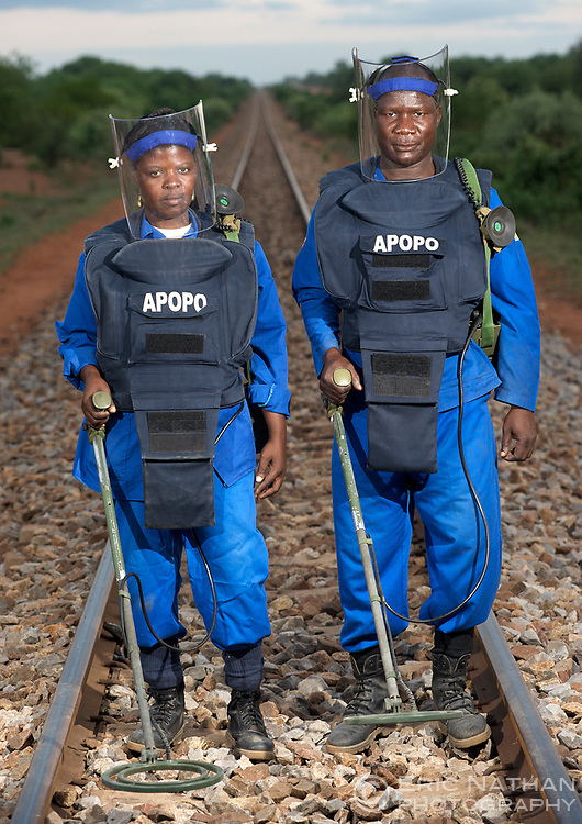 Portrait of APOPO manual deminers Isabel Simbe and Luis Vergonha with metal detectors on the Chokwe railway line in Gaza Province, Mozambique, December 2008.