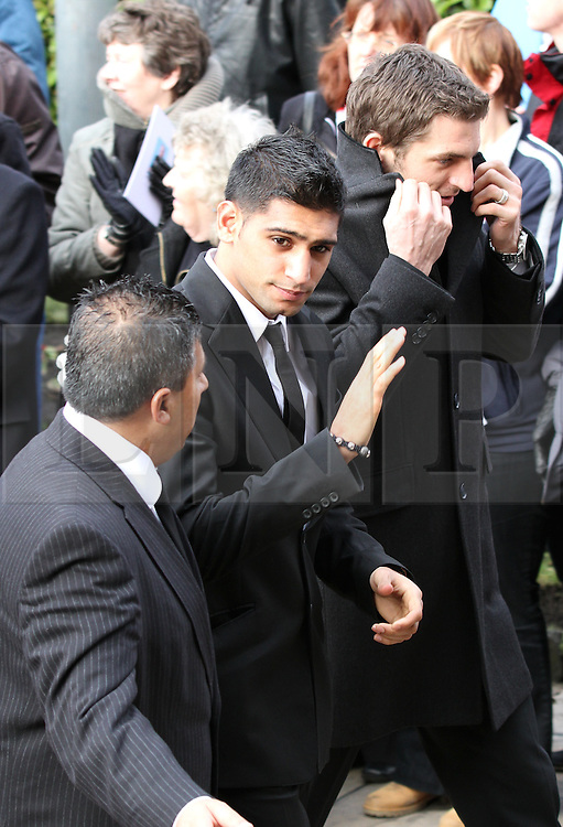 © under license to London News Pictures. 26/1/2011. Boxer Amir Khan arriving at the funeral of Bolton Wonderers and England star, Nat Lofthouse at Bolton Parish Church today (26/01/2011) Nat died at the age of 85. Photo credit should read:Joel Goodman/LNP