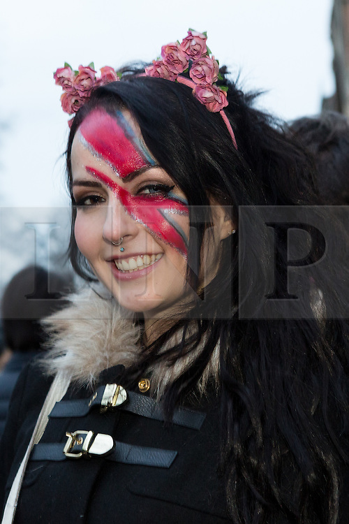 """© Licensed to London News Pictures. 17/01/2016. London, UK. Bowie fan, Louise Gilmour queues for a public tribute event called """"Starman: A celebration of David Bowie"""" at the Union Chapel in Highbury and Islington. The gig pays tribute and celebrates the life of David Bowie who died on 10 January 2016. Photo credit : Vickie Flores/LNP"""