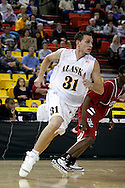 24 November 2005:  University of Alaska Anchorage junior forward James Hartman (31) cuts back door in the first half of the UAA Seawolves 60-65 loss to the South Carolina Gamecock's in the first round of the Great Alaska Shootout at the Sullivan Arena in Anchorage Alaska..