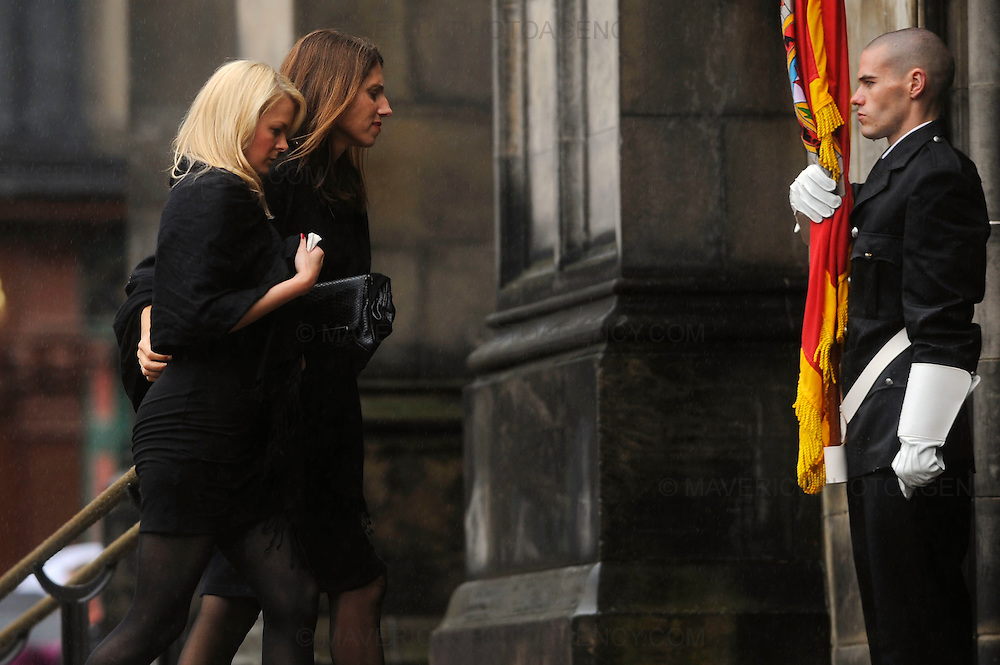 The funeral of Lothian and Borders fire fighter Ewan Williamson was held today in a private service at Edinburgh's St Giles Cathedral. The fire fighter was killed helping rescue people during a fire at the Balmoral Bar in Dalry Road, Edinburgh on 12th July 2009.  Pictured family members arrive at St Giles Cathedral for the funeral.