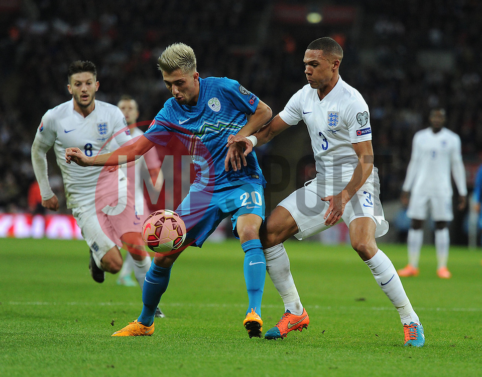 Kieran Gibbs (Arsenal) puts pressure on Kevin Kampl of Slovenia  - Photo mandatory by-line: Alex James/JMP - Mobile: 07966 386802 - 15/11/2014 - SPORT - Football - London - Wembley - England v Slovenia - EURO 2016 Qualifier