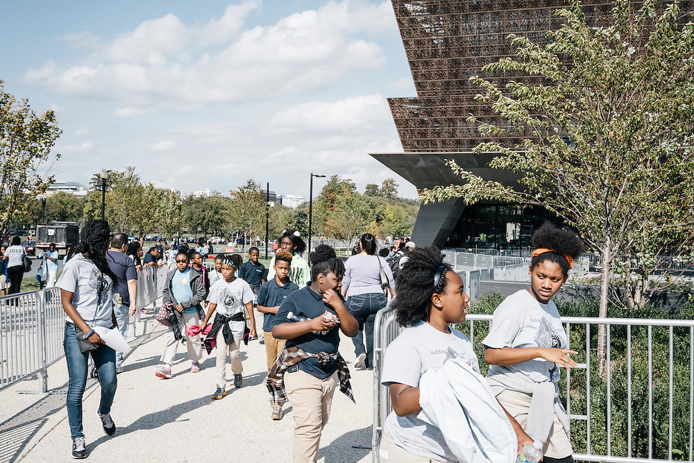 Sixth-graders from Knowledge Is Power Program (KIPP) DC, prepare to go inside the Smithsonian National Musuem of African American History and Culture in Washington, D.C. on Oct 21, 2016. The students spent an hour touring the new museum, which is only available to see with reserved tickets during the first year.