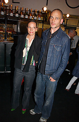 Artist DINOS CHAPMAN and his wife at the launch party for the fashion label Javovich-Hawk held at the Fifth Floor Cafe, Harvey Nichols, Knightsbridge, London on 27th April 2006.<br /><br />NON EXCLUSIVE - WORLD RIGHTS
