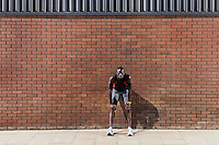 Man resting by wall
