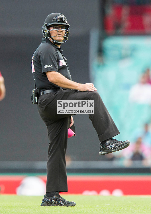KFC Big Bash League T20 2015-16 , Sydney Sixers v Sydney Thunder, SCG; 16 January 2016<br /> Umpire Gerard Abood signals leg byes and shows off the new umpires helmets