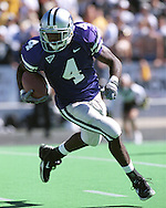 Kansas State defensive back Terence Newman rushes up field against Kansas at KSU Stadium in Manhattan, Kansas in 2001.