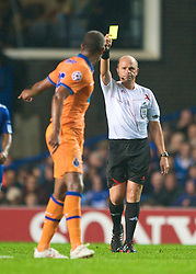 LONDON, ENGLAND - TUESDAY, SEPTEMBER 15th, 2009: Porto's Alvaro is booked for a foul on Chelsea's Michael Essien during the UEFA Champions League Group D match at Stamford Bridge. (Photo by Chris Brunskill/Propaganda)