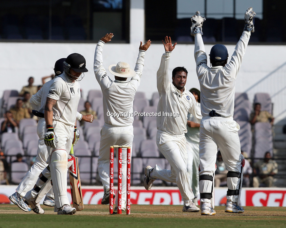 Indian bowler Pragiyan Ojha celebrates with team mates New Zealand batsman Brendon McCullum wicket during the 3rd test match India vs New Zealand day-4 Played at Vidarbha Cricket Association Stadium, Jamtha, Nagpur, 23, November 2010 (5-day match)