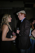 Damian Lewis and Abi Titmuss. Rushes Soho Shorts Awards evening. 23 Coventry St. London. 4 August 2005. ONE TIME USE ONLY - DO NOT ARCHIVE  © Copyright Photograph by Dafydd Jones 66 Stockwell Park Rd. London SW9 0DA Tel 020 7733 0108 www.dafjones.com