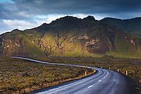 Road 54 through Berskerjahraun lava at Snæfellsnes Peninsula, Iceland. Mountain Bjarnarhafnarfjall in background. Þjóðvegur 54 í gegnum Berserkjahraun á Snæfellsnesi. Bjarnarhafnarfjall í baksýn.
