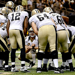 Sep 22, 2013; New Orleans, LA, USA; New Orleans Saints quarterback Drew Brees (9) in the huddle against the Arizona Cardinals during a game at Mercedes-Benz Superdome. The Saints defeated the Cardinals 31-7. Mandatory Credit: Derick E. Hingle-USA TODAY Sports