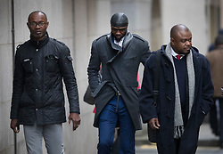 © Licensed to London News Pictures. 12/12/2016. London, UK. Bright Sodje (L) and Efe Sodje (C) arrive at the Old Bailey. Former Premier League player Sam Sodje and three of his brothers have been charged with fraudulent trading in connection with their Sodje Sports Foundation charity. Photo credit: Peter Macdiarmid/LNP