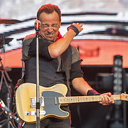 PIC BY GEOFF ROBINSON PHOTOGRAPHY 07976 880732.<br /> <br />  Picture shows Bruce Springsteen playing at the Ricoh Arena, Coventry,on June 3rd. <br /> <br /> Rock star Bruce Springsteen gave &pound;1000 to a baby hospice after a volunteer sent him a letter before his gig in Coventry.<br /> <br /> Pensioner Norman Miller, 74, wrote to The Boss telling him that Zoe's Place Baby Hospice may struggle to continue opening every day because of a shortage of cash.<br /> <br /> He was astonished to be invited for a meet and greet with the star after his show at the Ricoh Arena in Coventry last Friday and to receive the &pound;1,000 donation.<br /> <br /> &quot;I sent a letter to the Ricoh for Bruce asking for a drumstick or something which we could perhaps auction for the hospice,&quot; said Norman, who recently started volunteering.<br /> <br /> &quot;I didn't think much would come of it, but then I had a reply inviting me to the meet and greet after the show.<br /> <br /> &quot;It was amazing just to meet him and he started asking lots of questions about the hospice. Then when he gave me the donation, it was incredible, I couldn't believe it.&quot;<br /> <br /> Norman said Springsteen wanted to visit the hospice the next morning, but unfortunately it was too short notice to arrange.<br /> <br /> He added: &quot;In hindsight, I should have taken him, but hopefully next time he comes to England he will come and see us. He's an incredible man. He has done this out of the kindness of his heart.&quot;<br /> <br /> When Norman turned up at the hospice with the donation this week everyone was amazed.<br /> <br /> SEE COPY CATCHLINE  Springsteen donates baby hospice