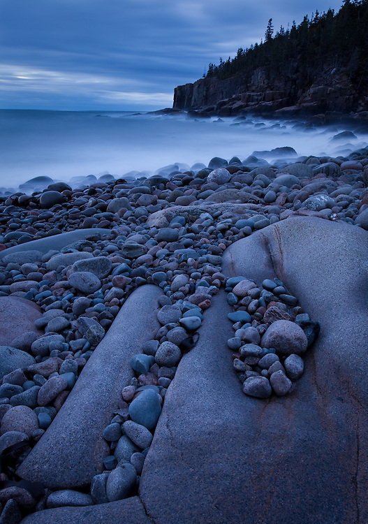 Twilight blues during a long exposure of cobble beach and Otter Cliff in Acadia National Park, Maine