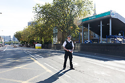 © Licensed to London News Pictures. 22/09/2016. LONDON, UK.  Police officer at the scene outside All Saints DLR station. A man was found dead in the street following a suspected assault, near All Saints DLR station just before midnight last night.  Photo credit: Vickie Flores/LNP