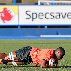 "CARDIFF, WALES - NOVEMBER 24: Teboho ""Oupa"" Mohoje going down on the ball with Jaco Kriel in support during the South African national rugby team training session at Cardiff Arms Park on November 24, 2014 in Cardiff, Wales. (Photo by Steve Haag/Gallo Images)"