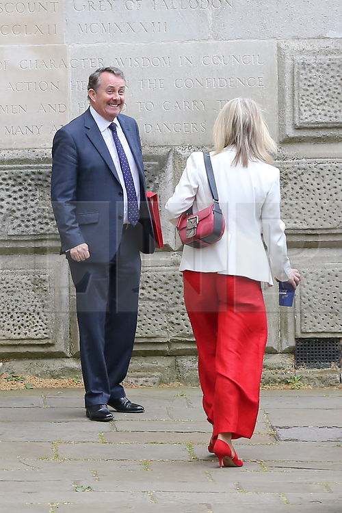 © Licensed to London News Pictures. 30/04/2019. London, UK. Liam Fox - Secretary of State for International Trade and President of the Board of Trade (L) and Liz Truss - Chief Secretary to the Treasury (R) departs from No 10 Downing Street after attending the weekly Cabinet meeting. Photo credit: Dinendra Haria/LNP